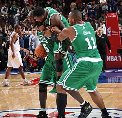 Nate Robinson and Glen Davis drape Kevin Garnett, who wins the game with a layup and a clinching steal.  (Getty Images)