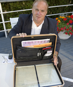 Ian Naismith, James Naismith's grandson, holds the two original documents outlining the rules of basketball. (Getty Images)
