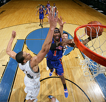 Amar'e Stoudemire shoots for two of his 36 points against JaVale McGee (left) and Yi Jianlian (rear). (Getty Images)