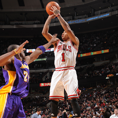 Derrick Rose -- 29 points and nine assists -- rises up and shoots a long-distance jumper over Kobe Bryant. (Getty Images)
