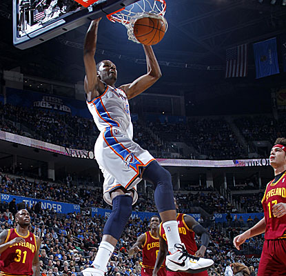 Kevin Durant slams home two of his game-high 25 points Sunday as the Thunder strike down the Cavs. (Getty Images)