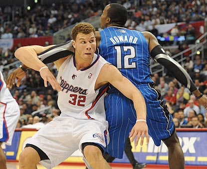 Blake Griffin stands his ground against Dwight Howard, but his Clippers teammates are no match for the rest of the Magic.  (US Presswire)