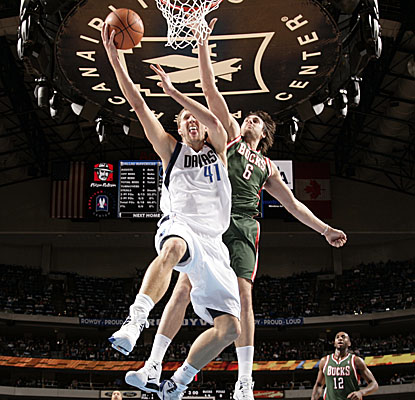Dirk Nowitzki skies for two of his game-high 30 points Monday in the Mavs' first loss in 13 games. (Getty Images)