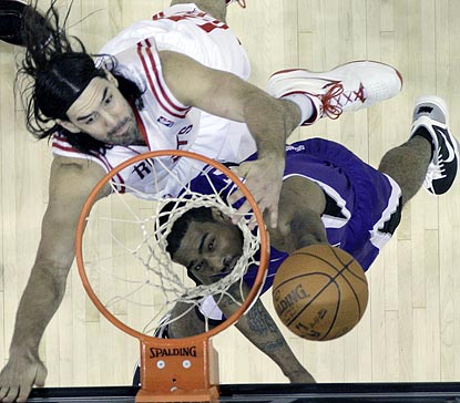 Sacramento's Luther Head (right) goes up for a shot while Houston's Luis Scola defends during the third quarter.  (AP)