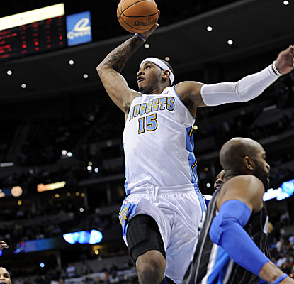 Melo gets a clear path for the dunk vs. the Magic on Tuesday, finishing with a game-high 35 points. (AP)