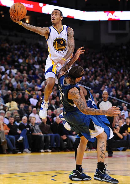 Monta Ellis, who winds up with a game-high 34 points, skies over Michael Beasley in the third quarter.  (US Presswire)
