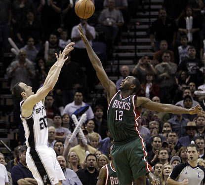 Manu Ginobili drills a game-winning, fallaway jumper over the outstretched arm of Luc Richard Mbah a Moute.  (AP)