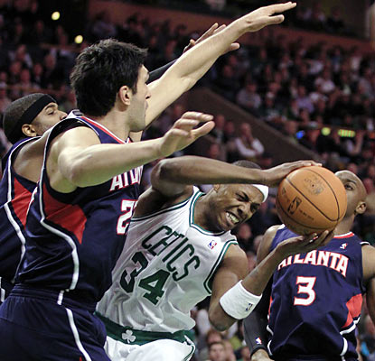 The Hawks swarm around Paul Pierce, but the veteran forward still produces 15 points and 10 assists in Boston's latest win.  (AP)