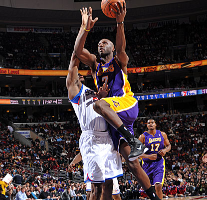 Lamar Odom sparks a 27-8 run in the fourth quarter Friday as the Lakers pull away from the Sixers. (Getty Images)