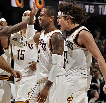 Mo Williams (center) celebrates the Cavs' win over the Knicks after pitching in for 23 points.  (Getty Images)