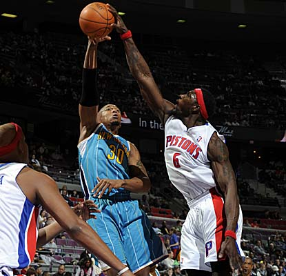 Playing his 999th game in the NBA on Sunday, Big Ben Wallace lays one of his patented stuffs on Hornets forward David West. (Getty Images)