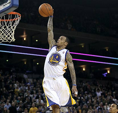 Monta Ellis puts on a show for the Golden State fans, but it's not enough to break the Warriors out of their malaise.  (AP)