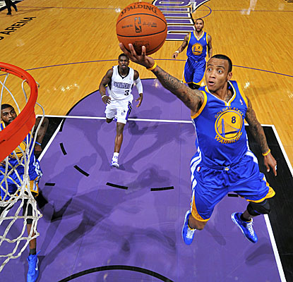 Monta Ellis leads the charge for Golden State, scoring 36 points in an overtime win over the Kings on Monday. (Getty Images)