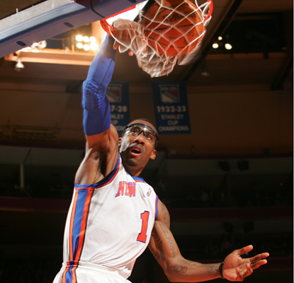 Amar'e Stoudemire puts home two of his 23 points as the Knicks snap a three-game losing streak. (Getty Images)