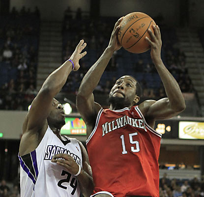 John Salmons (15), who slides past Carl Landry, contributes with 12 points and six assists to help fuel the Bucks.  (AP)