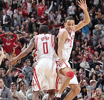 The Rockets' Aaron Brooks and Kevin Martin celebrate their win over the Wizards.  (Getty Images)