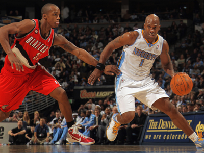 Chauncey Billups drives around Dante Cunningham on his way to score a team-high 18 points.  (Getty Images)