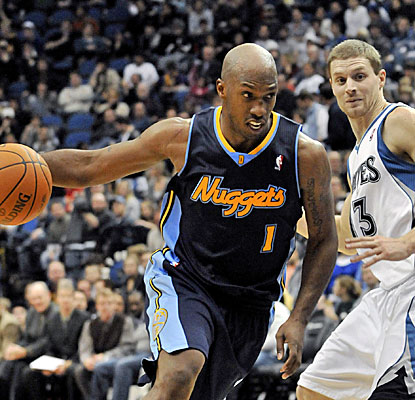 Chauncey Billups, left, leads the Nuggets with 36 points. Luke Ridnour, right, scores 20.  (AP)