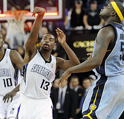 Tyreke Evans, left, watches his 45-foot shot as it goes in to beat the Grizzlies at the buzzer. (AP)
