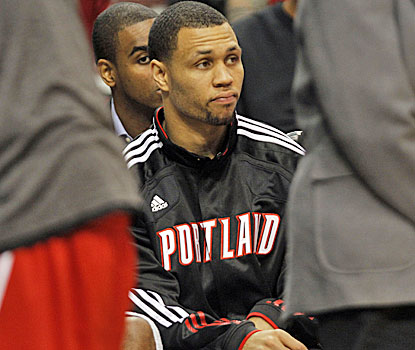 Brandon Roy watches from the bench, his future for this season in doubt because of injury.   (AP)