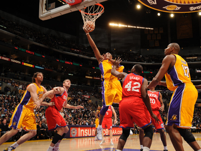 Kobe Bryant scores two of his game-high 33 points on this shot against the 76ers' Elton Brand. (Getty Images)