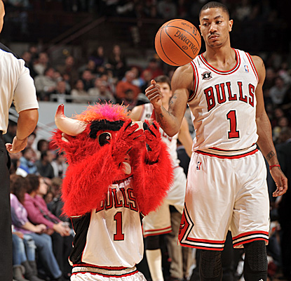 Derrick Rose gets some love from Benny before tallying a double-double to help the Bulls to a win. (Getty Images)