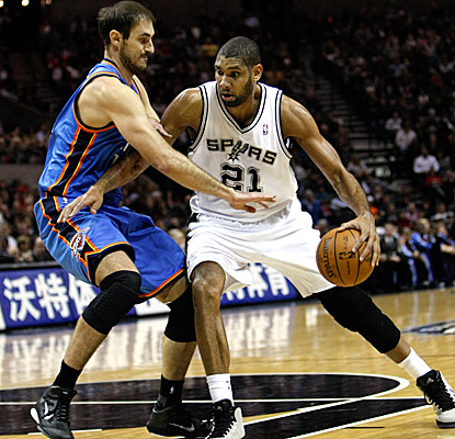 Tim Duncan posts up Thunder big man Nenad Krstic on Saturday, wrapping up with 21 points in the Spurs' home win. (US Presswire)