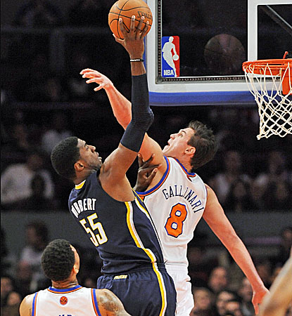 Indiana's Roy Hibbert (55) tries to shoot over New York's Danilo Gallinari, right. (AP)