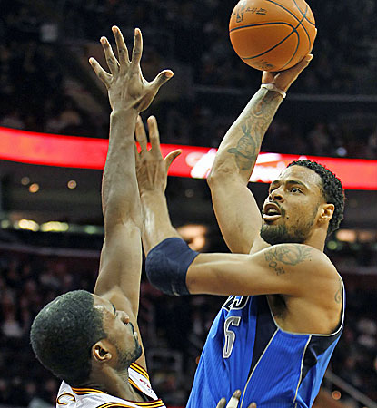 Dallas center Tyson Chandler, right, scores 14 points in the win over the Cavaliers. (AP)