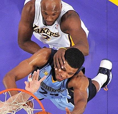 The Grizzlies' Rudy Gay and the Lakers' Lamar Odom battle for the ball under the basket in Los Angeles. (AP)