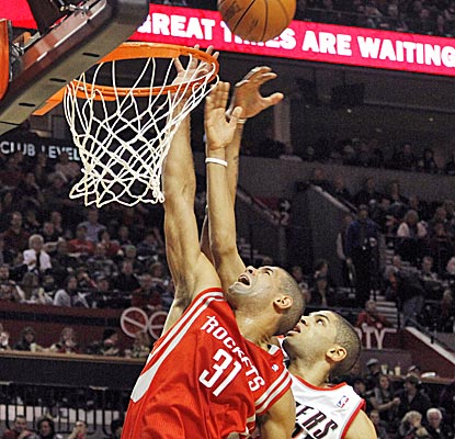 The Rockets' Shane Battier goes up for a rebound in front of Blazers forward Nicolas Batum. Batum finishes with 21 points.  (AP)