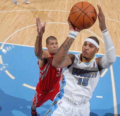 Melo looks to be back in shape after his bereavement leave, leading the Nuggets with 33 points.  (Getty Images)
