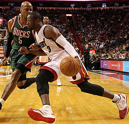 Dwyane Wade drives past Milwaukee's Corey Maggette, torching the visiting Bucks for 34 points. (Getty Images)