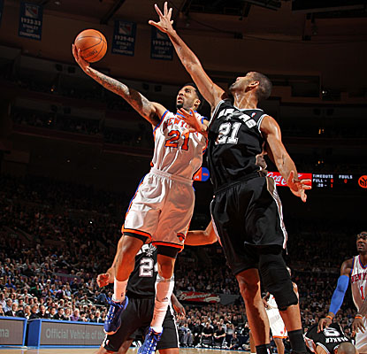 Wilson Chandler avoids the long arm of Tim Duncan, scoring a game-high 31 points in the Knicks' win. (Getty Images)