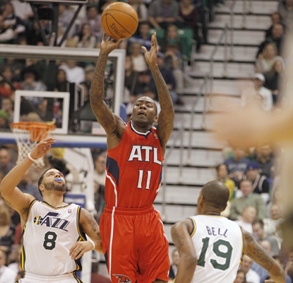 Jamal Crawford of the Hawks hits a half-court shot at the end of the first half and finishes the game with 26 points. (AP)