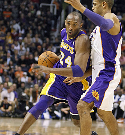 Kobe Bryant tries to drive on a Suns defender for two of his game-high 24 points. (AP)