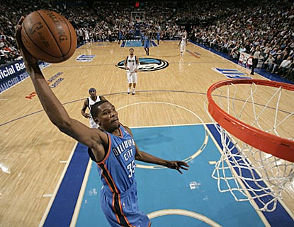 Kevin Durant makes 11 of his 22 field-goal attempts, most of which are more difficult than this one.  (Getty Images)