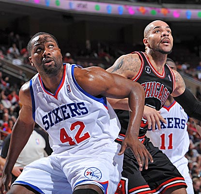 Elton Brand boxes out the Bulls' Carlos Boozer on a night when the Sixers shoot 78 percent in the third quarter. (Getty Images)