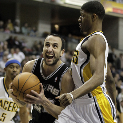 Manu Ginobili continues to play like a man possessed as he powers past the Pacers' Paul George.  (AP)