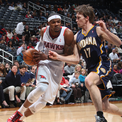 Josh Smith -- 27 points -- drives around the Pacers' Mike Dunleavy during an explosive third-quarter run.  (Getty Images)