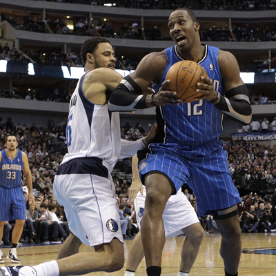 Dwight Howard -- 23 points -- power steps his way past the Mavericks' Tyson Chandler. (Getty Images)