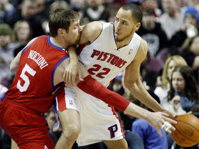 Tayshaun Prince fights to keep the ball out of the hands of 76ers' forward Andres Nocioni.  (Getty Images)