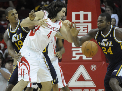 Utah's Paul Millsaps (24) plays solid defense against Luis Scola and the Rockets. (Getty Images)