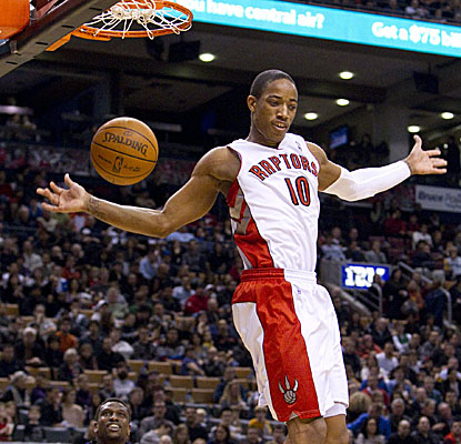 Raptors guard DeMar DeRozan finishes a dunk with flair Sunday vs. the visiting Kings. (AP)