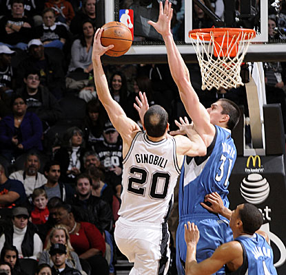 Spurs mainstay Manu Ginobili goes to the hoop vs. the Wolves, leading San Antonio to its 31st win. (Getty Images)
