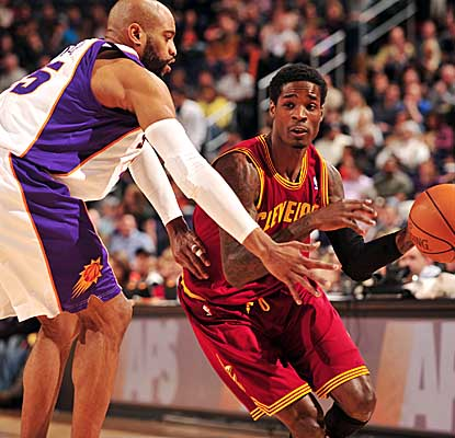 Rookie Manny Harris drives past the Suns' Vince Carter, scoring a season-high 27 points in the Cavs' loss. (Getty Images)