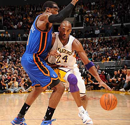Driving past Knicks star Amar'e Stoudemire, Kobe Bryant leads the Lakers' attack with 27 points. (Getty Images)