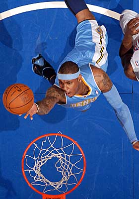 Seven-year veteran Carmelo Anthony has 21,476 NBA game minutes -- and counting -- under the hood. (Getty Images)
