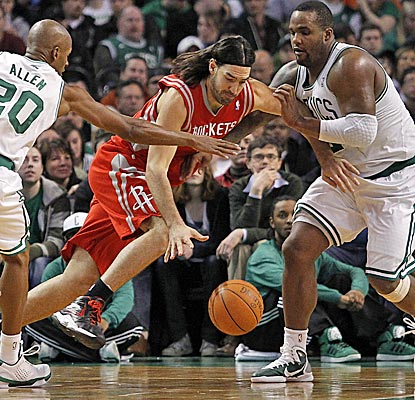 The Rockets' Luis Scola, driving against Ray Allen and Glen Davis, finishes with 12 points and nine rebounds. (US Presswire)