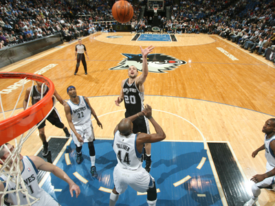 Manu Ginobili (20) leads the Spurs to their 16th straight win over a struggling Timberwolves team.  (Getty Images)